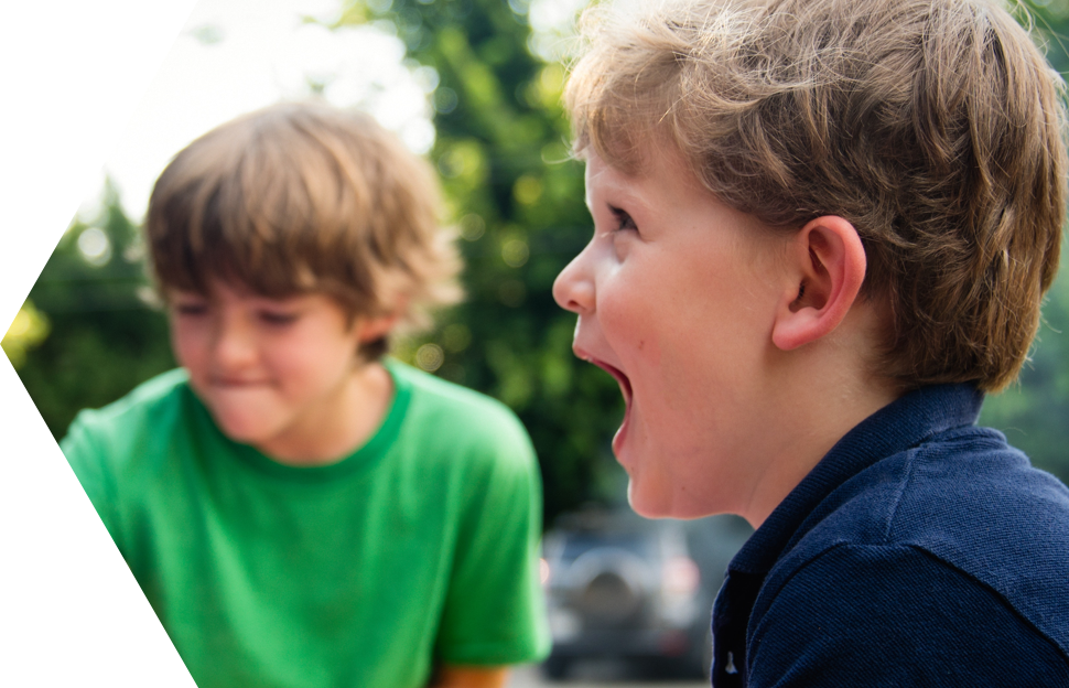 Two young boys playing outside